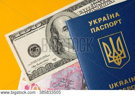 Ukrainian Citizen Passport With Us Dollars And Ukrainian Hryvnia Banknotes Inside. Going Abroad, Exc