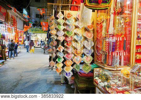 Haridwar, Garhwal, India - 3rd November 2018 : Auspicious Yellow Merchandise Hanging For Sale. At Mo