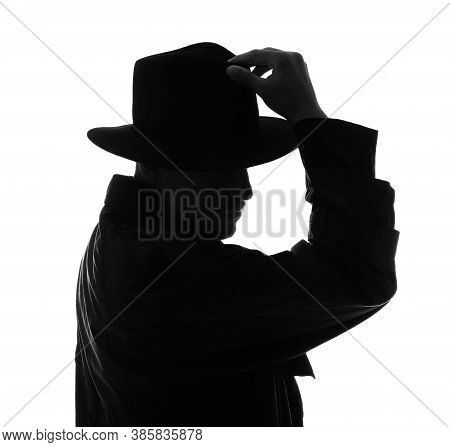 Silhouette Of Old Fashioned Detective On White Background