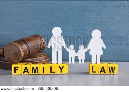 Cubes With Letters, Judge Gavel And Family Figure On Light Table. Family Law Concept