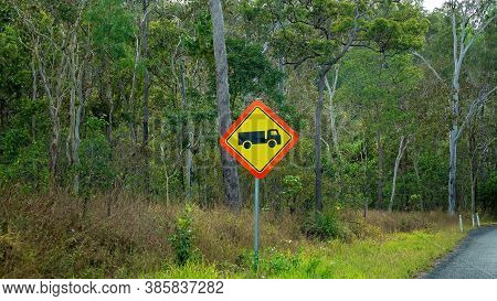 Truck Icon Roadside Sign Warning To Beware Of Large Vehicles Using The Road Through Bushland
