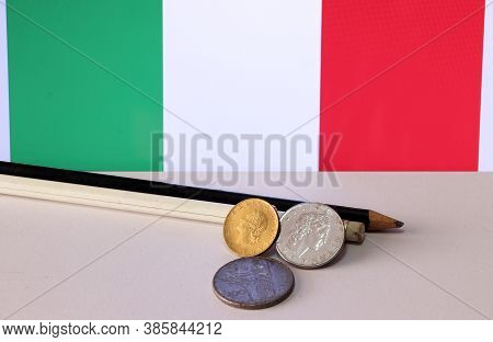 Heap Of Italy Coins And Pencil On White Floor With Italia Flag Background, Repvbblica Italiana, Lire