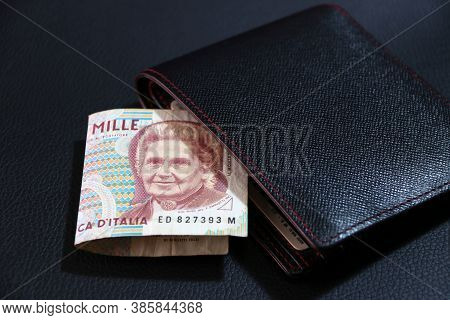 One Thousand Lire Of Italy Banknote With Black Wallet On The Black Floor, Lire Italia Money The Conc