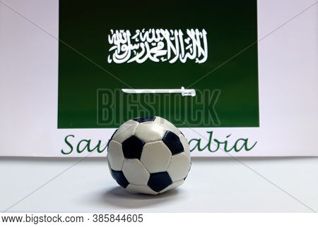 Small Football On The White Floor And Saudi Arabian Nation Flag With The Text Of Saudi Arabia Backgr