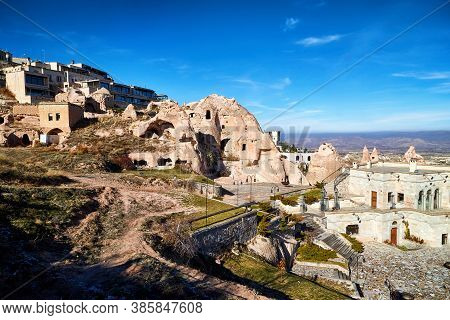 View On Cappadocia Rock Houses, Caves And Ruins In Goreme In Anatolia, Turkey. Ruins Of An Ancient C