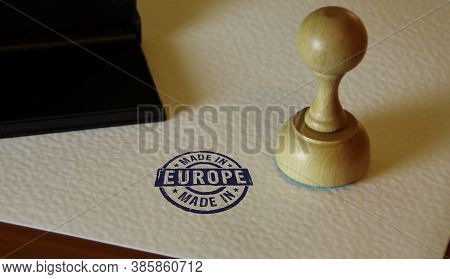 Made In Europe, Eu, European Union Stamp And Stamping Hand. Factory, Manufacturing And Production Co