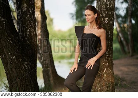 Fashionable Young Pretty Woman In The Park