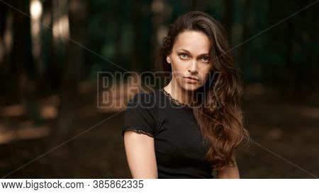 Pretty Young Woman With Long Curly Hair Outdoors Portrait