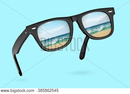 Classic Sunglasses With Reflection Of Sea Isolated On Blue Background