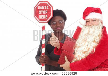 Santa and a young woman with a large sign Santa Stop Here