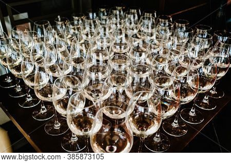 Glass Of White Wine On A Table. Many Glass Wine In A Row On Bar Counter. Shallow Depth Of Field. Gla