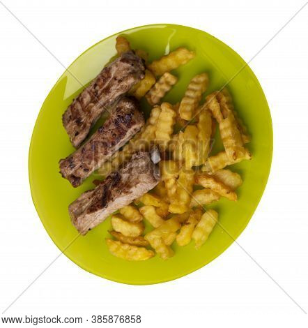 Grilled Pork Ribs With French Fries On Lime Plate. Pork Ribs With French Fries On A White Background
