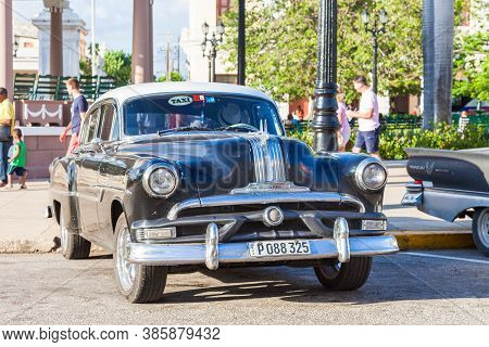 Cienfuegos, Cuba-october 13, 2016. Old, Classic American, Black Pontiac Chieftain 1953, Four Door Se