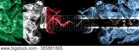 Italy Vs Botswana, Botswanan Smoky Mystic Flags Placed Side By Side. Thick Colored Silky Abstract Sm