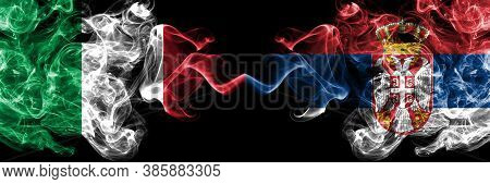 Italy Vs Serbia, Serbian Smoky Mystic Flags Placed Side By Side. Thick Colored Silky Abstract Smoke