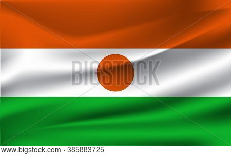 Realistic Waving Flag Of Republic Of Niger. Fabric Textured Flowing Flag Of Niger.
