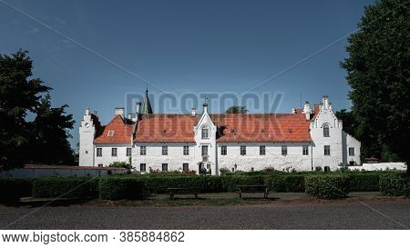 The White Facade And Orange Roof Of The Medieval Bosjökloster Castle On A Bright Summer Day In Swede