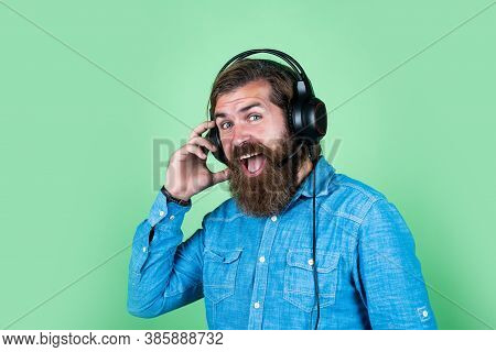 Cheerful Man Wear Modern Earphones. Male In Headphones Listen Music. Ebook And Elearning Concept. Ed