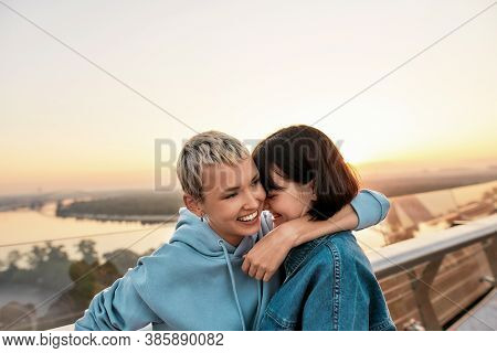 Young Lesbian Couple Hugging While Having Fun Together Outdoors, Two Girls Enjoying Romantic Moments