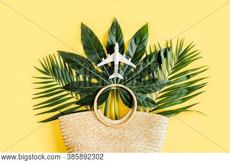 Bag Go To Zero Waste On The Background Of Tropical Leaves. Eco Shopping Bag From Rattan On Yellow Ba