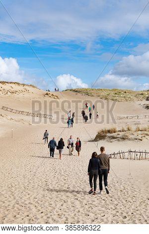 Nida, Lithuania - September 2020: Tourists In Wonderful Nagliai Nature Reserve In Neringa, Lithuania