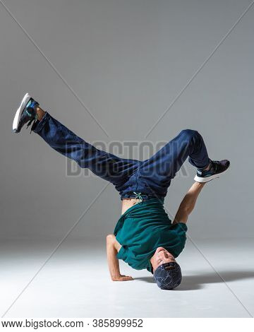 Sporty Guy Breakdancer Dancing On The Floor Isolated On Gray Background. Breakdance Poster