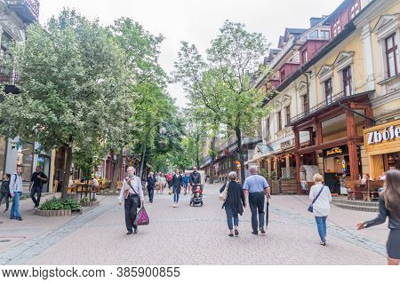 Zakopane, Poland - June 14, 2020: People Walking On Krupowki Promenade. Famous Touristic Street In Z