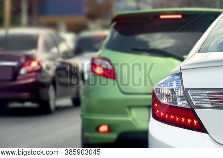 Cloup Up Of Rear White Car Driving On The Asphalt Road. With Blurred Of Other Cars During The City T