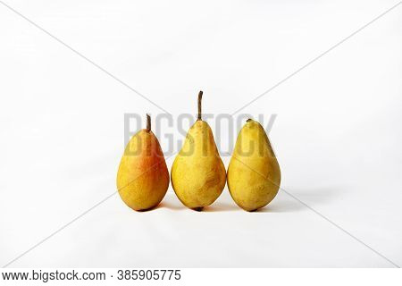 Pears. Three Ripe Juicy Pears Close-up Arranged On White Background