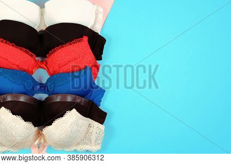 Set Of Womens Bra On Blue Background. Underwear Fashion Concept. Basic Lingerie Flatly Top View