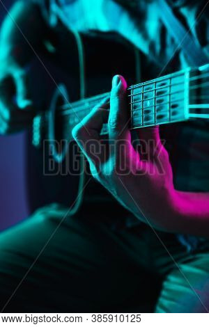 Close Up Of Guitarist Hand Playing Guitar, Macro. Concept Of Advertising, Hobby, Music, Festival, En