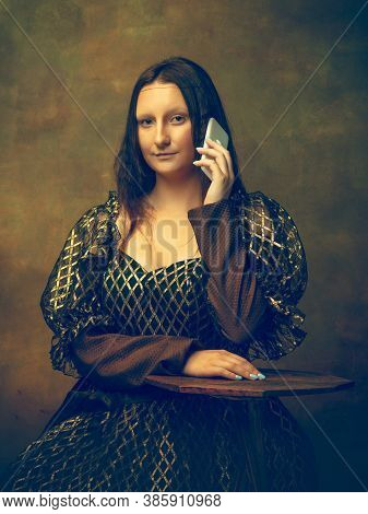 Phone Talking. Young Woman As Mona Lisa, La Gioconda Isolated On Dark Green Background. Retro Style,