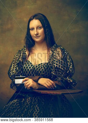Online Shop. Young Woman As Mona Lisa, La Gioconda Isolated On Dark Green Background. Retro Style, C