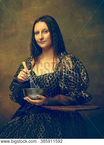 Cooking. Young Woman As Mona Lisa, La Gioconda Isolated On Dark Green Background. Retro Style, Compa