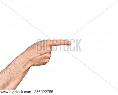 Hand of caucasian middle age man over isolated white background pointing with index finger to the side, suggesting and selecting a choice