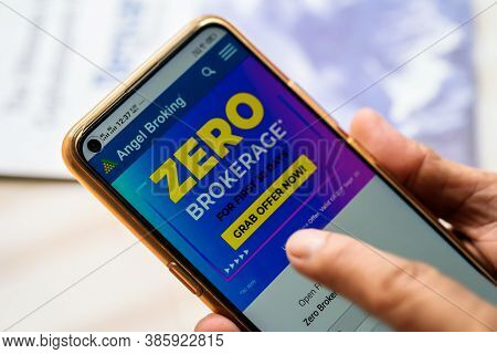 West Bengal, India, September 17, 2020 : Angel Broking Ipo. Hand Holding Mobile And Surfing Angel Br