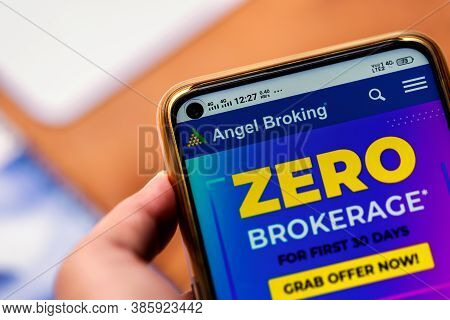 West Bengal, India, September 17, 2020 : Angel Broking Ipo. Hand Holding Mobile And Using Angel Brok