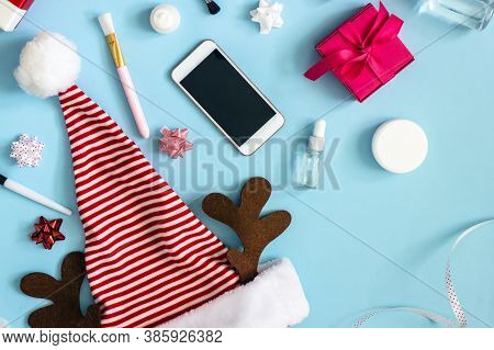 Christmas Online Shopping Cosmetics. Christmas Santa Hat In Red And White Stripes With Brown Elk Ant
