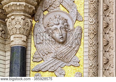 Angel Face. Decorative Stone Detail On The Facade Of The Navy Cathedral Of St. Nicholas In Kronstadt