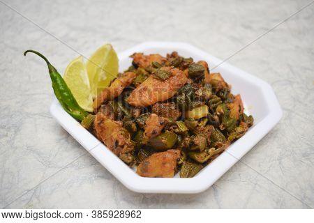 Side View Of Indian Curry Aloo Bhindi Or Alu Bhindi Sabzi Home Made, Cooked At Home With Indian Masa