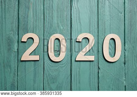 2020 Wooden Numbers On A Green Wooden Surface. New Year Twenty Twenty.