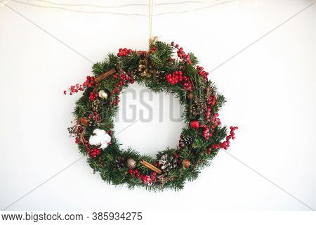 Christmas Wreath Hanging On White Wall In House