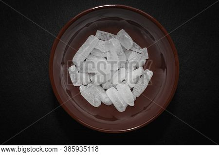 Top View Of White Cold Dry Ice Frozen Carbon Dioxide In A Red Bowl On A Dark Background
