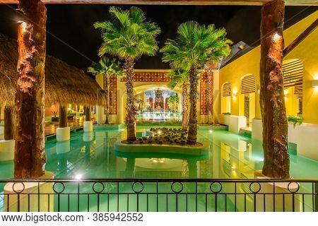 Iberostar Resort, Cancun, Yucatan Peninsula, Mexico, October 31, 2015: Decorative Lobby Pool at Night.