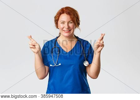 Medicine, Healthcare And Coronavirus Concept. Optimistic Female Medical Worker Hoping For Better. Re