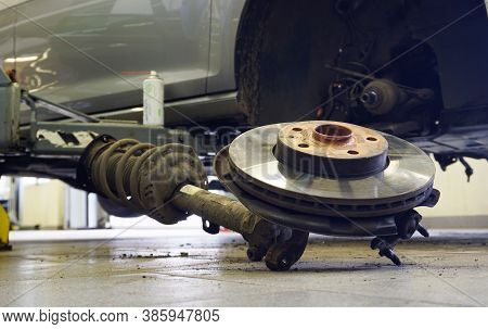 The Shock Absorber Assembly With The Hub And Brake Disc Is Removed From The Car. Focus On The Brake