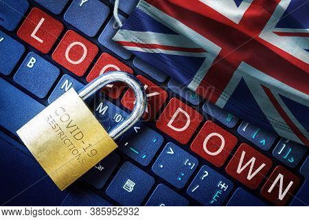 Uk Covid-19 Coronavirus Lockdown Restrictions Concept Illustrated By Padlock On Laptop Red Alert Key