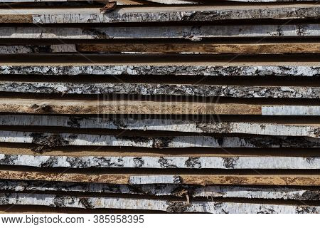 Wooden Boards Are Laid To Dry. A Stack Of Natural Boards, Raw Birch Boards With Birch Bark, Close-up