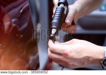 Man Fixing Car Dent By Himself. Bodyshop