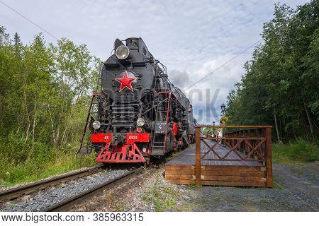 Ruskeala, Russia - August 15, 2020: Soviet Steam Locomotive Lv-0522 And The Ruskealsky Express Retro